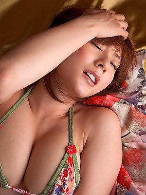 Arousing asian goddess in a kimono plays with her plump tits