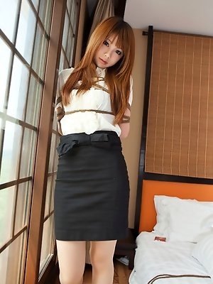 Dimdim Asian in tight office skirt and blouse is tied in ropes