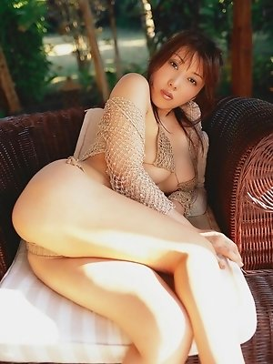 Beautifully stacked asian babe with big busty tits in a bikini