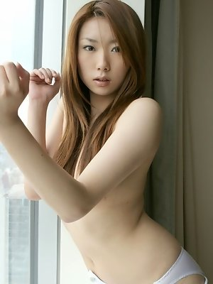 Yuu is a lovely Asian babe with perfect tits and ass who enjoys flaunting