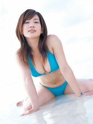 Enchanting asian chick tempts at the beach with her soft boobs