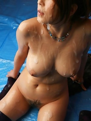 Naughty Asian slut gets covered in cum at bukkake party with her friends