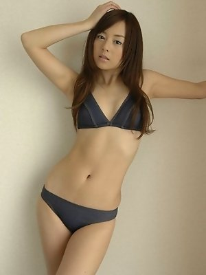 Sexy asian model shows off her arousing curves in a bikini