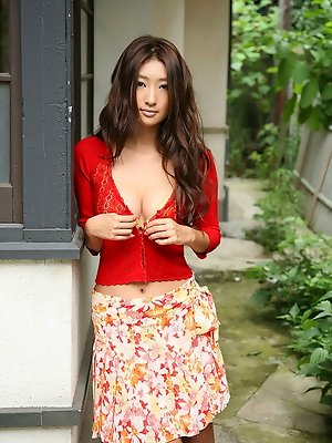 Sexy gravure idol beauty slowly takes off her pink kimono