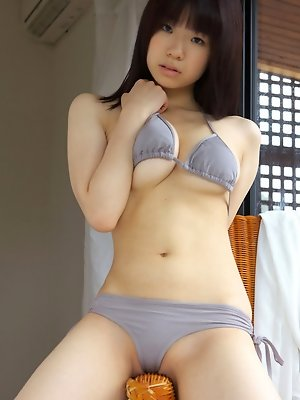 Azusa Togashi Asian plays with her big assets and shows hot ass