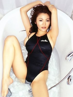Busty asian is incredibly hot with her big boobs in a swim suit