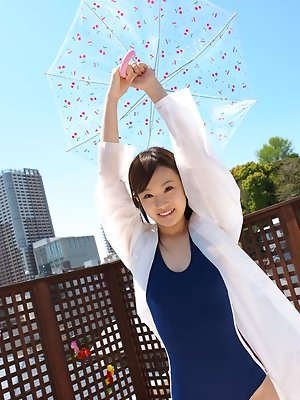 Kana Yuuki Asian in bath suit plays with umbrella in the balcony